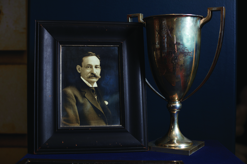 Trophy and framed photo of a man.