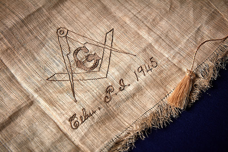 Linen fabric with Masonic crest embroidered on it.